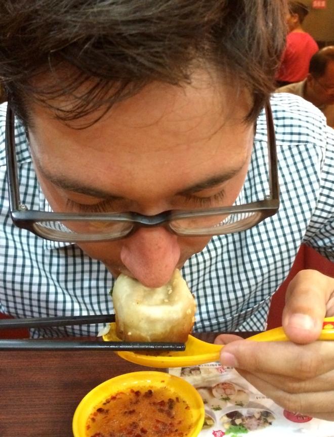 Derrick slurping up dumpling broth. Mmm