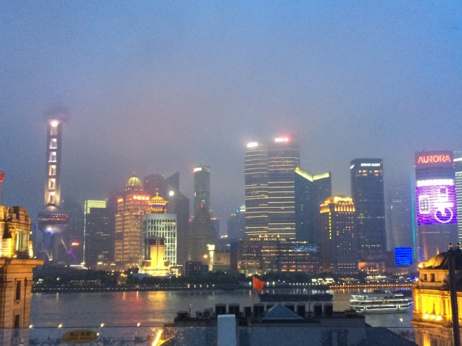 A foggy Shanghai skyline in between bouts of rainfall.